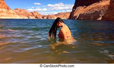 Bikini Woman taking a relaxing bath in the Lake Powell Utah...