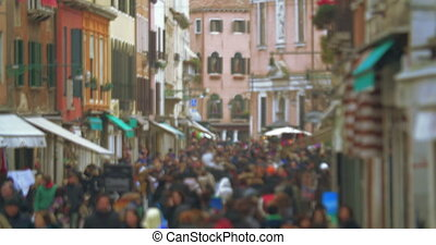 Crowd of people walking along Venetian street - Slight...
