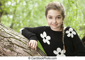 Adorable laughing child in forest - An Adorable laughing...