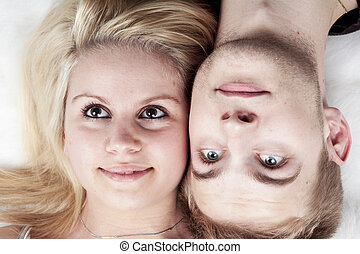 happy young loving couple embracing, white background - A...