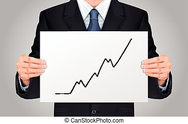 businessman holding growing business graph - close-up look...