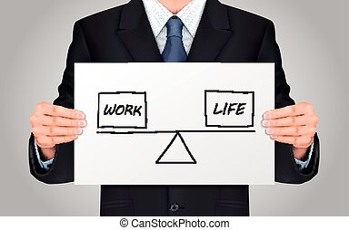 businessman holding life and work balance concept