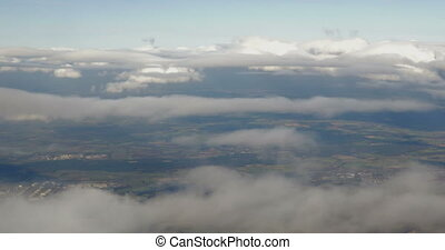 Aerial view to city through the clouds - View from the...