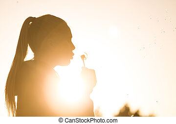 overexposed girl in summer - teenage girl backlit by the sun...