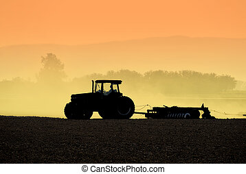 Tractor Silhouettes - Muted Backlit Silhouette of Two...