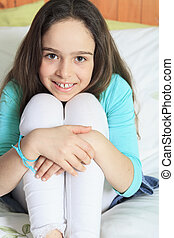 Little girl on bed - A Little girl on bed getting good time