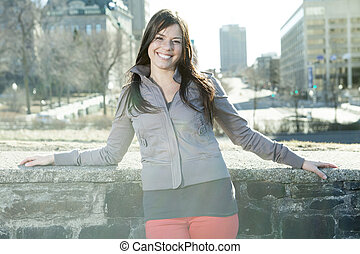 young beauty posing over city background