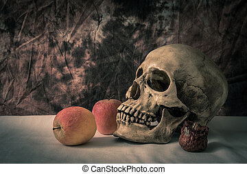 Still life with skull man with apples on a white floor