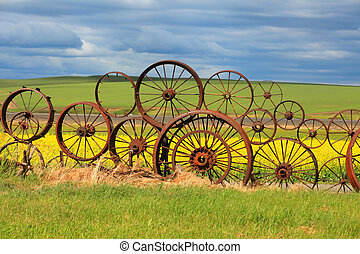 Fence of rusty wheels - Rusty wheels fence with scenic...