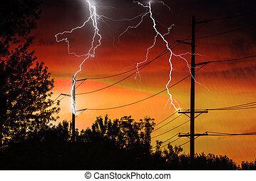 Silhouette of Power Lines being struck by lightning