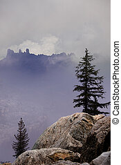 Rugged Mountain Tops - Rugged ridgeline obscured by clouds,...