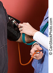 Testing Blood Pressure - A nurse checking the blood pressure...