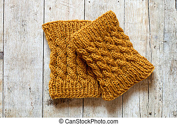 knitted wood legwarmers on wooden background