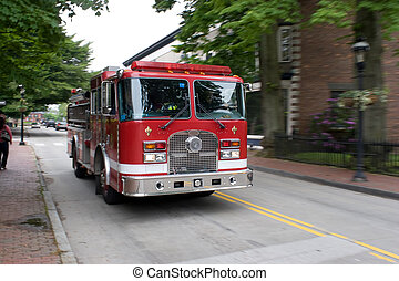 Moving Fire Engine - A fire engine speeding down the road....