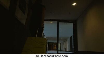 Woman with travel bag leaving hotel - Steadicam and low...