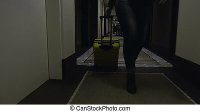 Woman tourist with suitcase arriving in the hotel -...