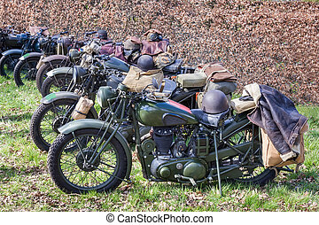 Green military motorcycles parked in a row for exhibition...