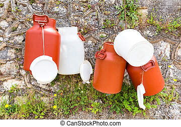 Hanging plastic white and brown milk cans - Plastic white...