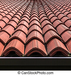 Tiled roof - Front view of a tiled roof brown.