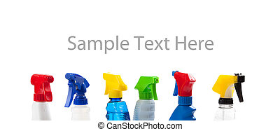 a row of assorted cleaning trigger bottles with copy space -...