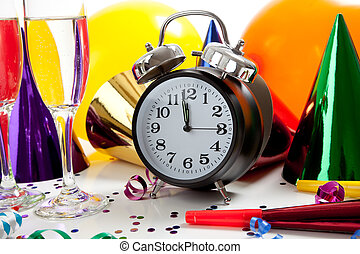 Assorted New Years Eve party supplies including party hats,...