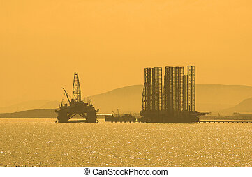 Oil rig during sunset in Baku, Azerbaijan in Caspian Sea