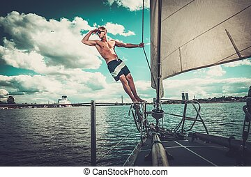 Handsome man on a regatta