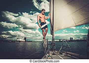 Handsome man on a regatta