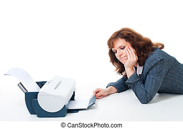 tired to wait until printer print document - Woman tired to...