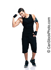 Happy fitness man showing his biceps - Full length portrait...