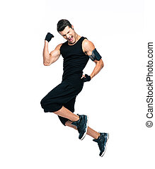 Cheerful fitness man jumping - Full length portrait of a...