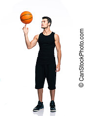 Basketball player spinning ball on his finger - Full length...