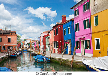 Burano island, Venice, Italy - multicolored houses over...
