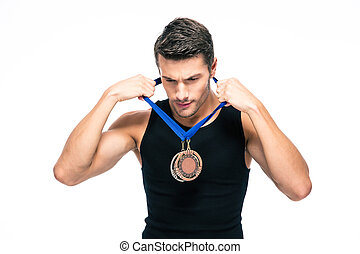 Fitness man puts on his medal isolated on a white background