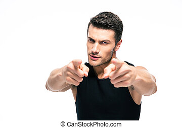 Fitness man pointing fingers at camera isolated on a white...