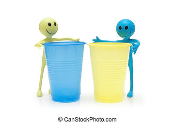 Two figures of Smileys and two plastic cups