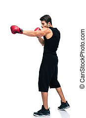 Sports man boxing in red gloves - Full length portrait of a...