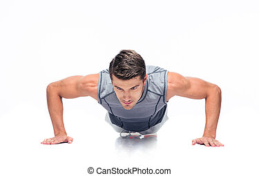 Fitness handsome man doing push ups isolated on a white...