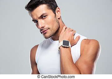 Portrait of a serious fitness man looking at camera