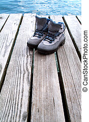 A pair of hiking boots near water