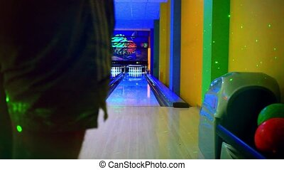 Young man playing bowling at night Straight beats HD...