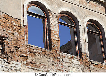 Brick wall of old destroyed house without windows