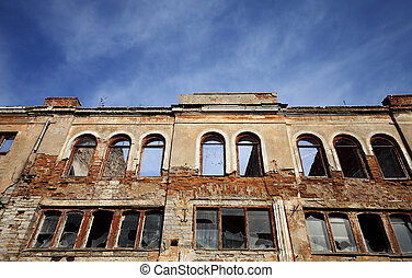 Facade of old destroyed house with broken windows Wide angle...