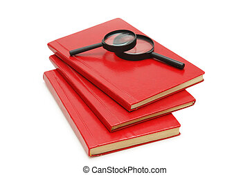 Three books and magnifying glasses isolated on white
