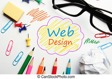Web design concept with some office supplies around it on...
