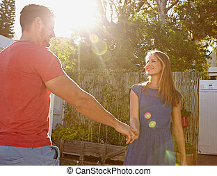 Beautiful young couple in love - Outdoors - Outdoor shot of...