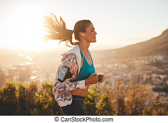 Beautiful young woman out for a run - Portrait of beautiful...