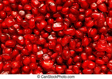Pomegranate seeds arranged as a background