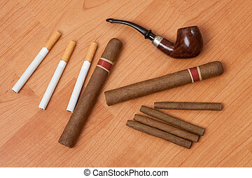 smoking accessories on wooden background