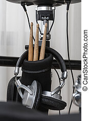 drum sticks and headphones closeup on the drum set